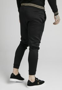 SIKSILK - ELEMENT MUSCLE FIT CUFF JOGGERS - Tracksuit bottoms - black/gold - 2