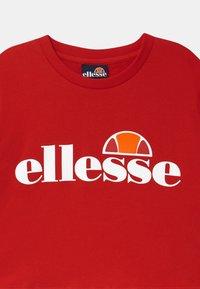 Ellesse - NICKY - Triko spotiskem - red - 2