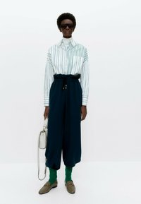 Uterqüe - MIT KOMBINIERTEM STREIFENPRINT  - Button-down blouse - white - 1