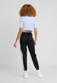 adidas Originals - TRACK PANTS - Träningsbyxor - black - 2