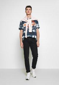 Vivienne Westwood Anglomania - CLASSIC - Jeans slim fit - dark blue denim - 1