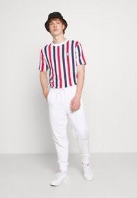 Calvin Klein Jeans - MICRO BRANDING PANT - Teplákové kalhoty - white - 1