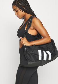 adidas Performance - ESSENTIALS 3 STRIPES SPORTS DUFFEL BAG UNISEX - Sports bag - black/black/white - 0