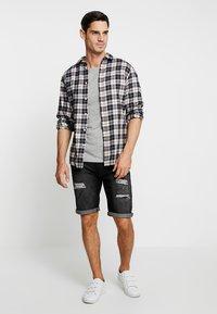 INDICODE JEANS - KADEN HOLES - Denim shorts - black - 1