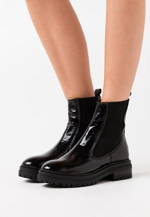 FALL PATENT - Platform ankle boots - black