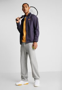 Nike Performance - PANT HERITAGE - Träningsbyxor - grey heather - 1