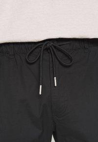 Topman - TECH BUNGEE - Cargo trousers - black - 3