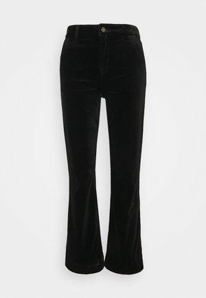 JENORA - Flared Jeans - black