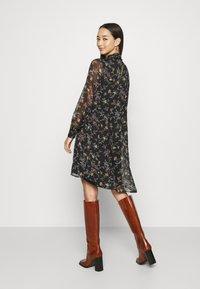 Vero Moda - VMTILI HIGH NECK SHORT DRESS - Day dress - black/tiny - 2