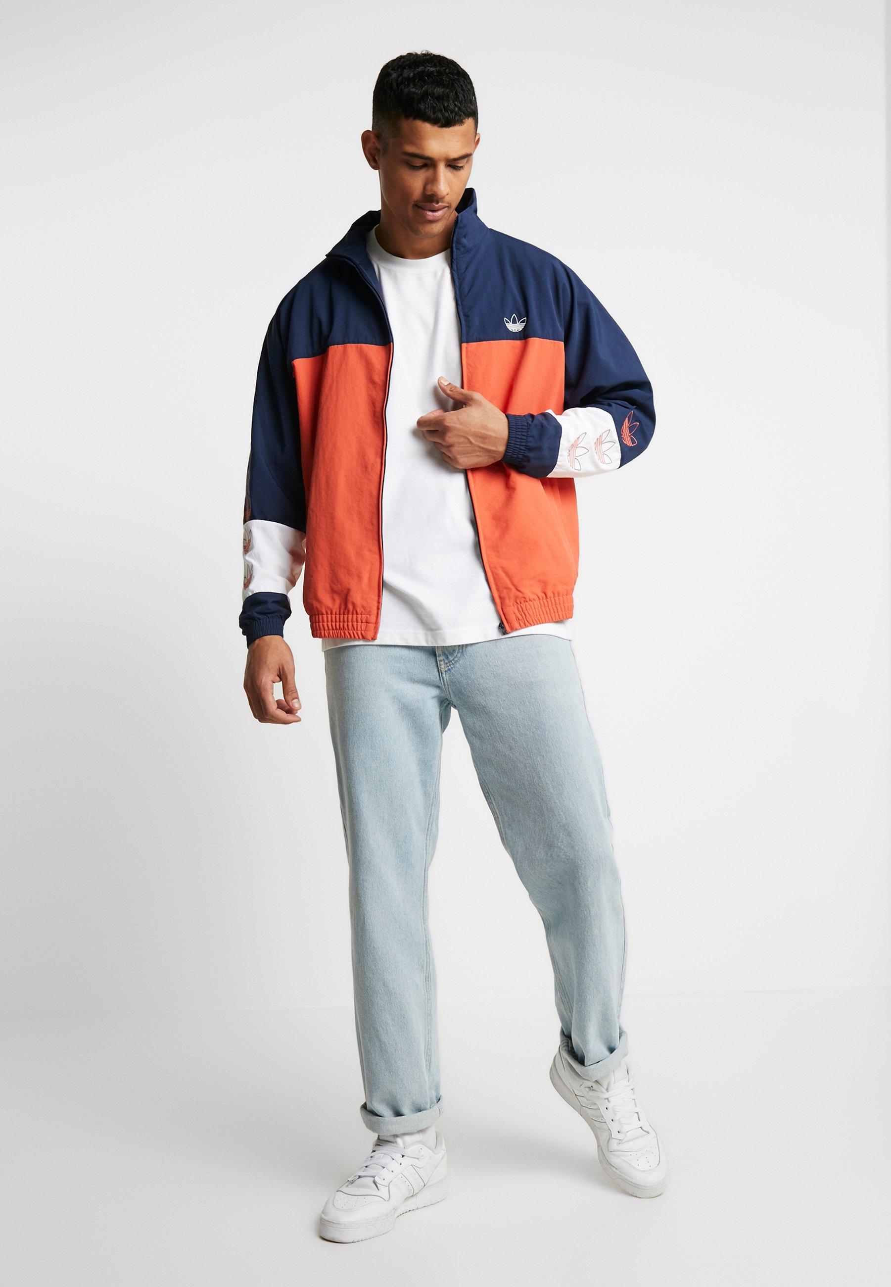 adidas Blocked Warum Up Winterjacke orange blau