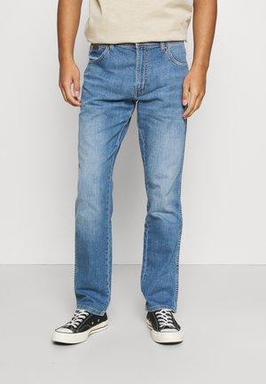 TEXAS - Straight leg jeans - light strike
