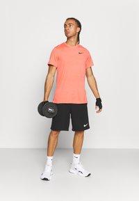 Nike Performance - DRY SUPERSET - T-shirt - bas - magic ember/black - 1