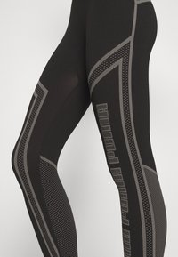 Puma - EVOSTRIPE EVOKNIT - Leggings - black - 4