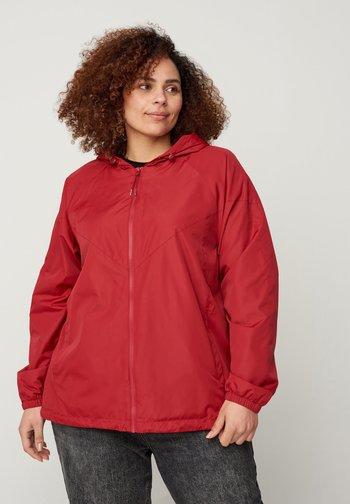 MIT REISSVERSCHLUSS UND KAPUZE - Outdoor jacket - red