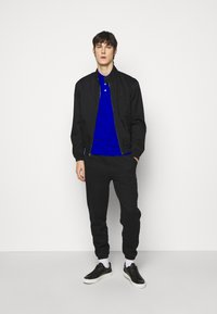 Polo Ralph Lauren - Tracksuit bottoms - polo black - 1