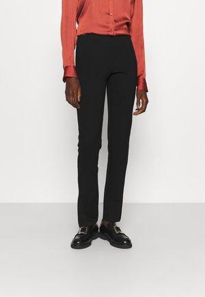 PCKARLA SLIT LEGGINGS - Kalhoty - black