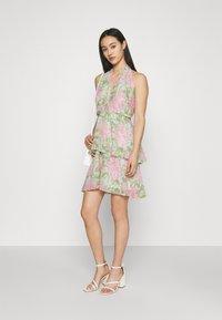 Gina Tricot - EXCLUSIVE MALVA HALTERNECK DRESS - Koktejlové šaty/ šaty na párty - pink - 1