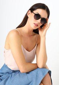 Komono - MADISON - Sunglasses - matte black/tortoise - 1