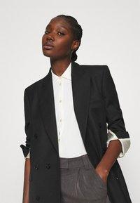 Hope - NITE - Short coat - black - 3