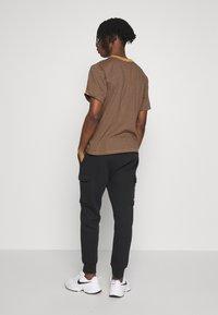 Nike Sportswear - Verryttelyhousut - black - 2