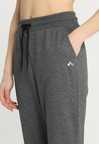 ONLY Play - ONPELINA PANTS - Tracksuit bottoms - dark grey melange - 4