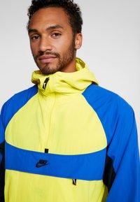Nike Sportswear - RE-ISSUE - Windbreakers - dynamic yellow/game royal/black - 5
