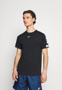 Nike Sportswear - REPEAT TEE - T-shirt med print - black - 0