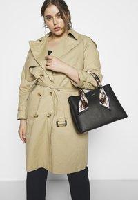 ALDO - TWEEDIA - Handbag - black - 1
