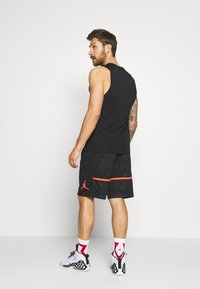 Jordan - JUMPMAN CAMO SHORT - Sports shorts - black/infrared - 2