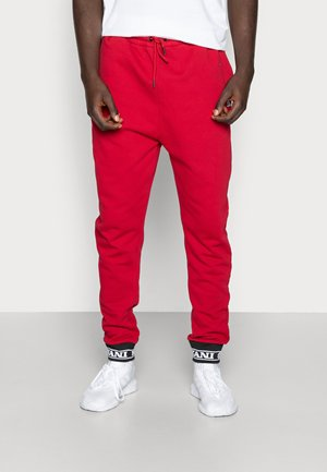 RETRO TRACKPANTS - Tracksuit bottoms - red