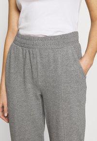 ONLY - ONLDEA DETAIL PANTS  - Tracksuit bottoms - medium grey melange - 4
