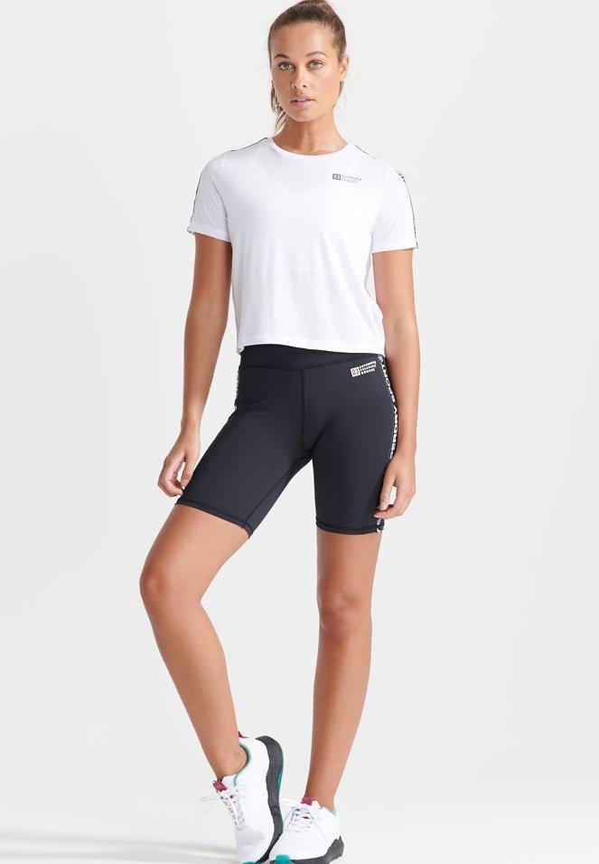 Damen SPORT GYM TECH TAPED CROP  - T-Shirt print