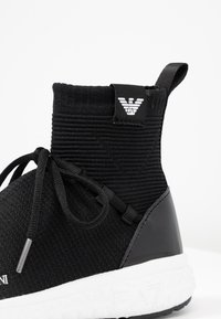 Emporio Armani - High-top trainers - black - 2