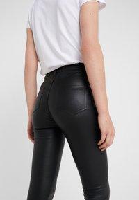 KARL LAGERFELD - PATENT BIKER PANTS - Leather trousers - black - 5