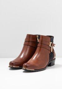 Caprice - Ankle boots - cognac/ocean - 4