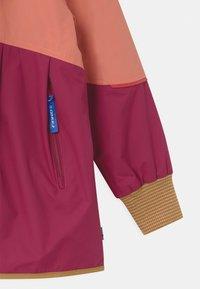Finkid - AINA MOVE UNISEX - Waterproof jacket - rose/cinnamon - 2
