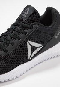 Reebok - FLEXAGON ENERGY TR - Zapatillas de entrenamiento - black/true grey/silver metallic - 5