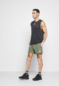 adidas Performance - OWN THE RUN RESPONSE RUNNING  - Sports shorts - green - 1