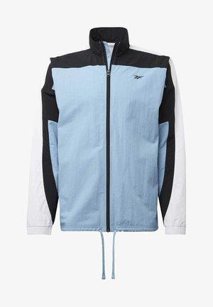 LES MILLS® TRACK JACKET - Veste de survêtement - blue