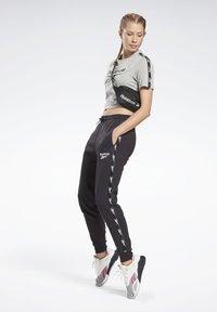 Reebok - TAPE JOGGERS - Pantaloni sportivi - black - 1