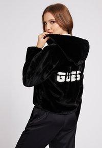 Guess - Winter jacket - schwarz - 2