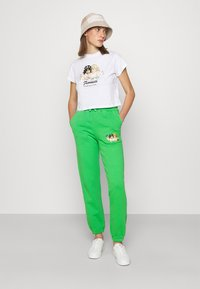 Fiorucci - WOODLAND VINTAGE ANGELS PATCH FOREST - Tracksuit bottoms - green - 1