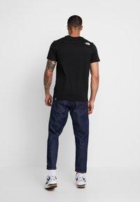 The North Face - SHOULDER LOGO TEE - Print T-shirt - black/white - 2