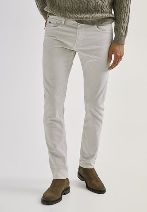 ENTBASTETE  - Trousers - beige