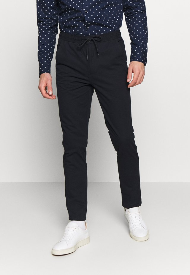 SLIM WASHED JOGGER - Trousers - navy