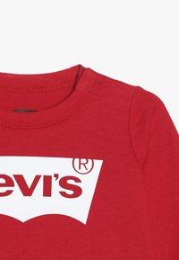 Levi's® - BATWING UNISEX - Långärmad tröja - super red - 3
