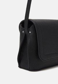 Calvin Klein - FLAP XBODY - Sac bandoulière - black - 3