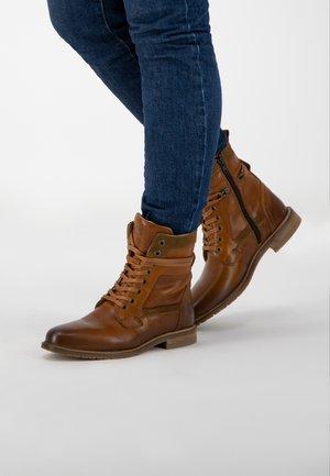 LACANAU - Lace-up ankle boots - cognac