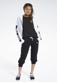Reebok - PANT - Teplákové kalhoty - black - 1