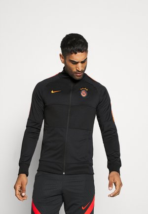 GALATASARAY - Club wear - black/vivid orange